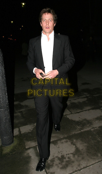 HUGH GRANT.Cirque Du Soleil charity performance at the Royal Albert Hall and aftershow dinner at the V&A Museum.5 February 2004.full length, full-length .www.capitalpictures.com.sales@capitalpictures.com.© Capital Pictures.