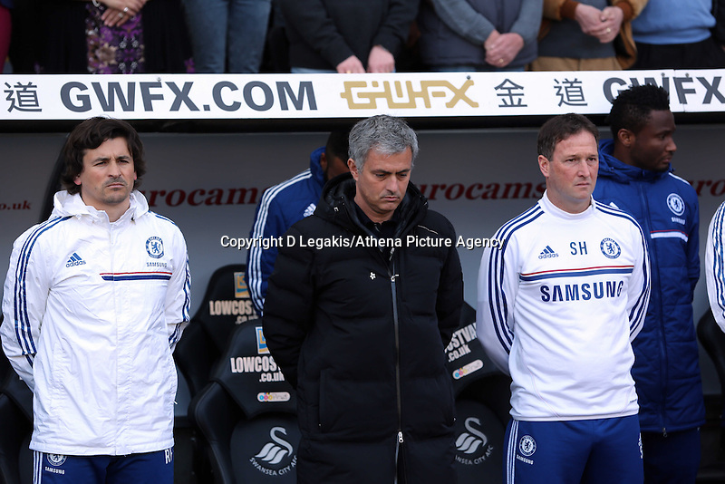 Sunday, 13 April 2014<br /> Pictured: Chelsea bench with Jose Mourinho (C) observe a minute's silence before kick off.<br /> Re: Barclay's Premier League, Swansea City FC v Chelsea at the Liberty Stadium, south Wales,