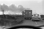 Man jumping off the back of a lorry North Yorks Moors. Yorkshire 1968