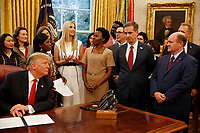 "First Daughter and Advisor to the President Ivanka Trump makes remarks prior to United States President Donald J. Trump signing the National Security Presidential Memorandum to Launch the ""Women's Global Development and Prosperity"" Initiative in the Oval Office of the White House in Washington, DC on Thursday, February 7, 2019.  Listening at far right is United States Senator Chris Coons (Democrat of Delaware).<br /> Credit: Martin H. Simon / CNP/AdMedia"
