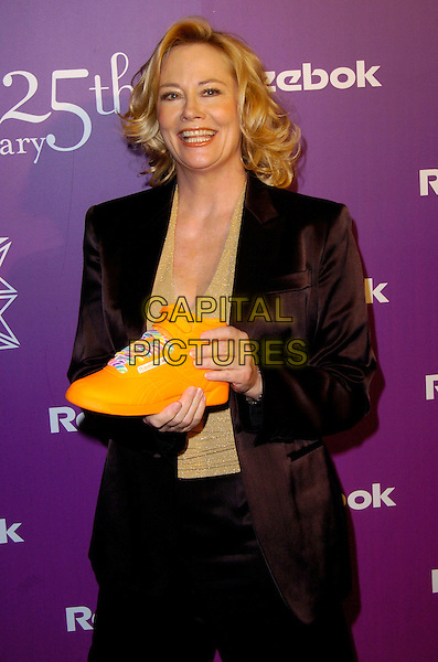 "CYBILL SHEPHERD.At the Reebok 25th anniversary celebration of ""The Freestyle"" at Culture Club, New York, New York, USA,.21 February 2007..half length holding orange trainer shoe trainers .CAP/ADM/BL.©Bill Lyons/AdMedia/Capital Pictures. *** Local Caption ***"