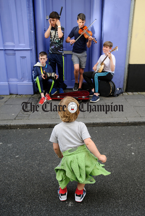 A youngster dances a wiggle on O Connell street, Ennis during Fleadh Cheoil na hEireann. Photograph by John Kelly.