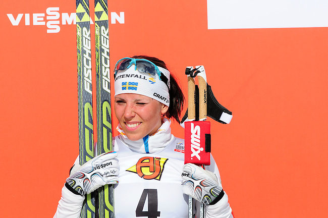 FALUN, SWEDEN - March 24: Charlotte  Kalla of Sweden (SWE) on the podium, finishing 3rd place, during the winner«s ceremony after the Viessmann Ladies Handicap 10km F at the FIS Cross country World Cup Final on March 24, 2013 in Falun, Sweden. (Photo by Dirk Markgraf)