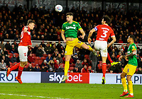 Preston North End's Jordan Storey heads at goal under pressure from Middlesbrough's George Friend<br /> <br /> Photographer Alex Dodd/CameraSport<br /> <br /> The EFL Sky Bet Championship - Middlesbrough v Preston North End - Wednesday 13th March 2019 - Riverside Stadium - Middlesbrough<br /> <br /> World Copyright &copy; 2019 CameraSport. All rights reserved. 43 Linden Ave. Countesthorpe. Leicester. England. LE8 5PG - Tel: +44 (0) 116 277 4147 - admin@camerasport.com - www.camerasport.com