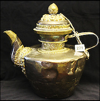 BNPS.co.uk (01202 558833)<br /> Pic: HAldridge/BNPS<br /> <br /> The battered old teapot.<br /> <br /> A man who took an old silver teapot along to TV's Flog It is celebrating today after it led to a record 140,000 pounds sale.<br /> <br /> Experts on the BBC show valued the item, that originated from the Far East, at 120 pounds, prompting the owner to reveal he had five other heirlooms at home.<br /> <br /> After digging the relics out he sold them at auction for the six figure sum, setting a record for the highest amount ever achieved on the popular programme.<br /> <br /> The show is very much like the Antiques Roadshow except that people go on to sell their treasures at auction which is also filmed by the Beeb.<br /> <br /> The unnamed owner took the 12ins tall teapot along to a valuation day held last month at Longleat House, Wilts.