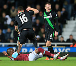 West Ham's Enner Valencia gets caught by Stoke's Charlie Adam who protests his innocence<br /> <br /> Barclays Premier League - West Ham United v Stoke City - Upton Park - England -12th December 2015 - Picture David Klein/Sportimage