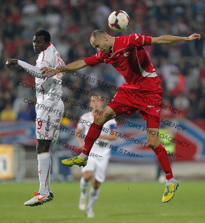 Fudbal Super liga season 2013-2014<br /> Radnicki Nis v Crvena Zvezda<br /> Abiola Dauda (L) and Rados Bulatovic (R)<br /> Nis, 26.10.2013.<br /> foto: Srdjan Stevanovic/Starsportphoto &copy;