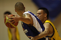 Lindsay Tait tries to get past Taranaki guard Jordan Mills during the National basketball league match between the Wellington Saints  and Taranaki Mountainairs at TSB Bank Arena, Wellington, New Zealand on Friday, 9 April 2010. Photo: Dave Lintott / lintottphoto.co.nz