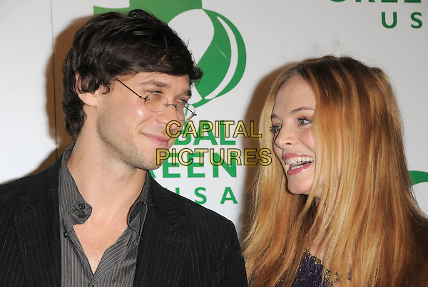 YANIV RAZ & HEATHER GRAHAM.The 6th Annual Global Green USA Pre-Oscar Party benefiting Green Schools held at Avalon in Hollywood, California, USA..February 19th, 2009.headshot portrait couple couple .CAP/DVS.©Debbie VanStory/Capital Pictures.
