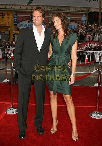 "RANDE GERBER & CINDY CRAWFORD.""Ocean's Thirteen"" Los Angeles Premiere held at Grauman's Chinese Theatre, Hollywood, California, USA..June 5th, 2007.full length black suit jacket green dress married husband wife bracelet .CAP/ADM/RE.©Russ Elliot/AdMedia/Capital Pictures"