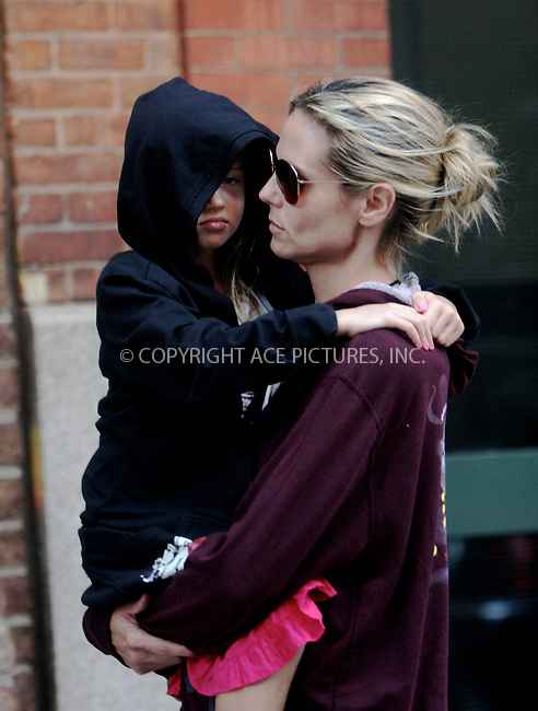 WWW.ACEPIXS.COM . . . . .  ....July 10 2011, New York City......Model Heidi Klum carries her daughter Leni in Tribeca on July 10 2011 in New York City....Please byline: NANCY RIVERA- ACEPIXS.COM.... *** ***..Ace Pictures, Inc:  ..Tel: 646 769 0430..e-mail: info@acepixs.com..web: http://www.acepixs.com