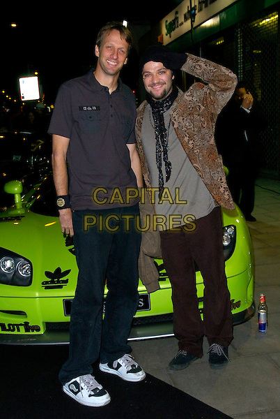 TONY HAWK & BAM MARGERA .The Gumball 3000 Miles - film premiere, KOKO, London, UK..November 30th, 2006.full length coat jacket beige paisley jeans denim gloves car salute.CAP/CAN.©Can Nguyen/Capital Pictures