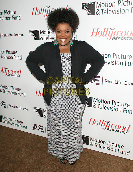 Yvette Nicole Brown.'Reel Stories, Real Lives' Celebration of the Motion Picture & Television Fund' 90 Years of Service to the Community and Recognizes The Hollywood Reporter's Next Generation Class of 2011 held at Milk Studios in Los Angeles, California, USA..full length black jacket dress hands on hips white grey gray print dress .CAP/RKE/DVS.©DVS/RockinExposures/Capital Pictures.
