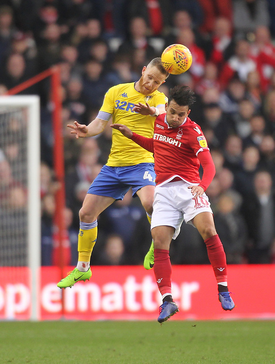 Leeds United's Adam Forshaw jumps with Nottingham Forest's Joao Carvalho<br /> <br /> Photographer Mick Walker/CameraSport<br /> <br /> The EFL Sky Bet Championship - Nottingham Forest v Leeds United - Tuesday 1st January 2019 - The City Ground - Nottingham<br /> <br /> World Copyright © 2019 CameraSport. All rights reserved. 43 Linden Ave. Countesthorpe. Leicester. England. LE8 5PG - Tel: +44 (0) 116 277 4147 - admin@camerasport.com - www.camerasport.com