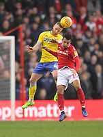 Leeds United's Adam Forshaw jumps with Nottingham Forest's Joao Carvalho<br /> <br /> Photographer Mick Walker/CameraSport<br /> <br /> The EFL Sky Bet Championship - Nottingham Forest v Leeds United - Tuesday 1st January 2019 - The City Ground - Nottingham<br /> <br /> World Copyright &copy; 2019 CameraSport. All rights reserved. 43 Linden Ave. Countesthorpe. Leicester. England. LE8 5PG - Tel: +44 (0) 116 277 4147 - admin@camerasport.com - www.camerasport.com