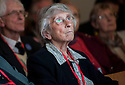 "Jean Barkley whose son Alistair died when Pan Am Flight 103 crashed at the town of Lockerbie, Scotland, watches the premiere of Al Jazeera's, ""Lockerbie: What Really Happened?"" at the Scottish Parliament."