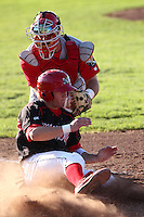 Williamsport Crosscutters catcher Cameron Rupp (50) attempts to tag Colin Walsh during a game vs the Batavia Muckdogs at Dwyer Stadium in Batavia, New York July 25, 2010.   Batavia defeated Williamsport 8-1.  Photo By Mike Janes/Four Seam Images