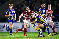 Picture by Alex Whitehead/SWpix.com - 09/03/2017 - Rugby League - Betfred Super League - Warrington Wolves v Wigan Warriors - Halliwell Jones Stadium, Warrington, England - Wigan's Morgan Escare makes a break from Warrington's Kurt Gidley.