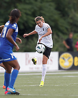 Portland Thorns FC forward Christine Sinclair (12) passes the ball.  In a National Women's Soccer League (NWSL) match, Portland Thorns FC (white/black) defeated Boston Breakers (blue), 2-1, at Dilboy Stadium on July 21, 2013.