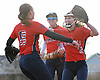 Jessica Budrewicz #9 MacArthur pitcher, right, celebrates with teammates #8 Shannon Myles, left, and #15 Ali Verdi after their 5-2 win over Oceanside in a Nassau County varsity softball game at Oceanside High School on Thursday, Mar. 31, 2016. MacArthur overcame a one-run deficit in the top of the seventh inning by plating four runs for the victory.