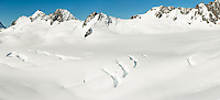 Bismarck Peaks and mountain ranges of Southern Alps with Explorer Glacier crevasses in upper parts of Fox Glacier NEVE, Westland Tai Poutini National Park, West Coast, UNESCO World Heritage Area, New Zealand, NZ