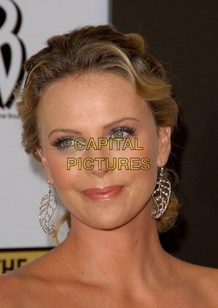 CHARLIZE THERON.The 11th Annual Critics Choice Awards held at The Santa Monica Civic Auditorium in Santa Monica, California .January 9th, 2006.Ref: DVS.headshot portrait dangling silver earrings.www.capitalpictures.com.sales@capitalpictures.com.Supplied By Capital PIctures