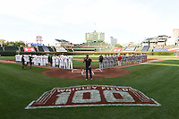 Teams line up on the field during the national anthem sung by Robbie Gold before the Under Armour All-American Game on August 16, 2014 at Wrigley Field in Chicago, Illinois.  (Mike Janes/Four Seam Images)