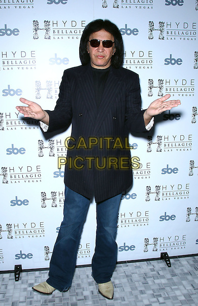 Gene Simmons.Nick Simmons celebrates his 23rd birthday with family jewels and performance at Hyde Bellagio, Las Vegas, Nevada, USA, 9th March 2012..full length pinstripe jacket blue jeans  navy hands sunglasses gesture .CAP/ADM/MJT.© MJT/AdMedia/Capital Pictures.