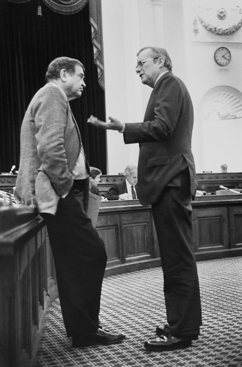 "During a Ways and Means Committee hearing, Rep. Daniel David ""Dan"" Rostenkowski, D-Ill., Chairman of the Ways and Means Committee, and Nicholas Frederick Brady, R-N.J., Secretary of the Treasury, chat. December 6, 1991 (Photo by Maureen Keating/CQ Roll Call)"