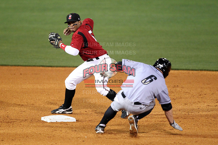 Nashville Sounds second baseman Eric Farris #5 turns a double play as Johnny Giavotella slides in during a game against the Omaha Storm Chasers at Greer Stadium on April 25, 2011 in Nashville, Tennessee.  Omaha defeated Nashville 2-1.  Photo By Mike Janes/Four Seam Images
