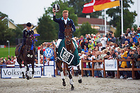 Niklas Lindback (SWE) at the lap of honour. Malmo City Horse Show FEI World Cup Eventing Qualifier CIC***.<br /> Niklas Lindback and Mister Pooh was placed 5th after Friday's dressage, 3rd after Saturday's cross country and finished after the show jumping as the Malmo FEI World Cup winner.<br /> At the Swedish Championships (a competition-in-the-competition) the couple was placed 2nd after Friday's dressage, 1st after Saturday's cross country and won during Sunday's show jumping.<br /> Eventing in Ribersborg, Malmo, Sweden.<br /> August 2011.<br /> Only for editorial use. <br /> Please note: Niklas is NOT riding Mister Pooh in this picture, for the price giving ceremony Pooh was replaced by another horse.