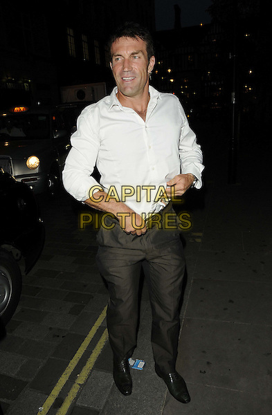 Pat Cash.The Slazenger Wimbledon Party, Aqua Nueva, Argyll St., London, England..June 28th, 2012.full length white shirt grey gray trousers .CAP/CAN.©Can Nguyen/Capital Pictures.
