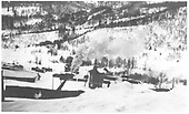 A townside view of Rico yards and tank in snow.  RGS 4-6-0 #22 is steamed up and ready to go.<br /> RGS  Rico, CO  1925