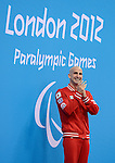 LONDON, ENGLAND 08/30/2012: Benoit Huot celebrating his gold medal for the Men's 200m IM - SM10 at the London 2012 Paralympic Games in the Aquatics Centre. (Photo by Matthew Murnaghan/Canadian Paralympic Committee)