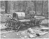 Abandoned remains of a automobile-based track buggy of some sort, perhaps belonging to a logger.