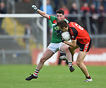 Keelan Sexton of Kilmurry Ibrickane in action against Cillian Brennan of Clondegad during their senior county final at Cusack park. Photograph by John Kelly.