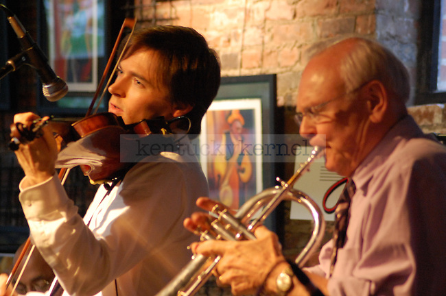 Zach Brock (left), a nationally known violinist and Lexington native, plays jazz music with his father Dan Brock, Jr. during  the 20th anniversary Jazz Arts Foundation Birthday Bash at Natasha's Cafe in downtown Lexington on Sunday April 25.  Photo by Brandon Goodwin | Staff