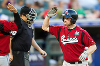 Nashville Sounds first baseman Jordan Brown #21 is greeted at home after hitting a 5th inning home run during the Pacific Coast League baseball game against the Round Rock Express on August 26th, 2012 at the Dell Diamond in Round Rock, Texas. The Sounds defeated the Express 11-5. (Andrew Woolley/Four Seam Images).