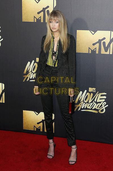 BURBANK, CA - APRIL 09: Model Gigi Hadid attends the 2016 MTV Movie Awards at Warner Bros. Studios on April 9, 2016 in Burbank, California.<br /> CAP/ROT/TM<br /> &copy;TM/ROT/Capital Pictures