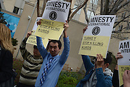 Washington, DC - March 31, 2016: A small group from Amnesty International protests against President Recep Tayyip Erdogan of Turkey outside of the Brookings Institution in the District of Columbia, March 31, 2016, ahead of Erdogan's speech at Brookings.  (Photo by Don Baxter/Media Images International)