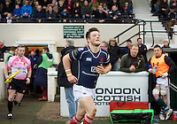 London Scottish players come out for their match against Ealing Trailfinders during the Greene King IPA Championship match between London Scottish Football Club and Ealing Trailfinders at Richmond Athletic Ground, Richmond, United Kingdom on 26 December 2015. Photo by Alan  Stanford / PRiME Media Images
