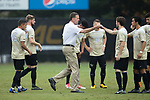 Wake Forest Demon Deacons head coach Bobby Muuss bumps fists with Luis Argudo (2) prior to the start of their ACC men's soccer tournament quarterfinal match against the Virginia Tech Hokies at Spry Soccer Stadium on November 5, 2017 in Winston-Salem, North Carolina.  The Demon Deacons defeated the Hokies 3-0.  (Brian Westerholt/Sports On Film)