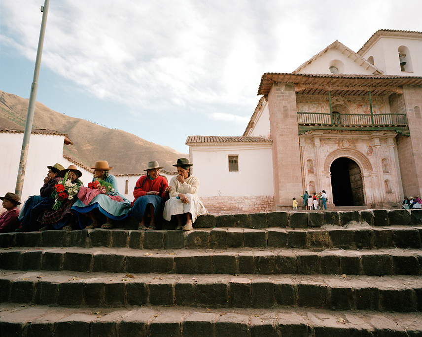 Peru, South America, southern hemisphere, Peruvian, Andahuaylillas, small town, locals, townspeople, Andean, Andes, church, indigenous, indigenous women, steps, hats, group, horizontal, copy space, fresco, balcony, tourism, Cuzco, mountain, mountainous, hill town, small town, remote, destination, travel, tourism