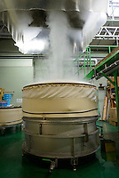 Rice being steamed. Miyashita Sake Brewery, Okayama city, Okayama pref, Japan, January 30, 2014. Okayama is famous for its earthy full-bodied sake. In January and February 2014 a 5-day tour of breweries in the prefecture was organised by Sake Brewery Tours (www.saketours.com).