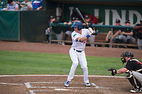 Ogden Raptors first baseman Dillon Paulson (14) at bat in front of catcher Gunnar Troutwine (33) during a Pioneer League game against the Great Falls Voyagers at Lindquist Field on August 23, 2018 in Ogden, Utah. The Ogden Raptors defeated the Great Falls Voyagers by a score of 8-7. (Zachary Lucy/Four Seam Images)