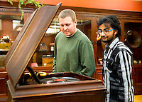 Mississippi State civil engineering majors Luke A. Baker, a senior from Macon, and Vipul Upadhyay, a sophomore from Nepal, look at a record player housed at the Charles H. Templeton Sr. Music Museum at Mitchell Memorial Library. The museum is home to more than 22,000 pieces of sheet music, 200 musical instruments and unique musical memorabilia from the 1880s-1930s. Viewing hours are 9 a.m.-4 p.m., Monday-Friday. <br />  (photo by Sarah Tewolde / &copy; Mississippi State University)