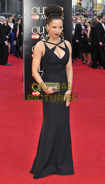 LONDON, ENGLAND - APRIL 13: Natalie Gumede attends the Olivier Awards 2014, Royal Opera House, Covent Garden, on Sunday April 13, 2014 in London, England, UK.<br /> CAP/CAN<br /> &copy;Can Nguyen/Capital Pictures
