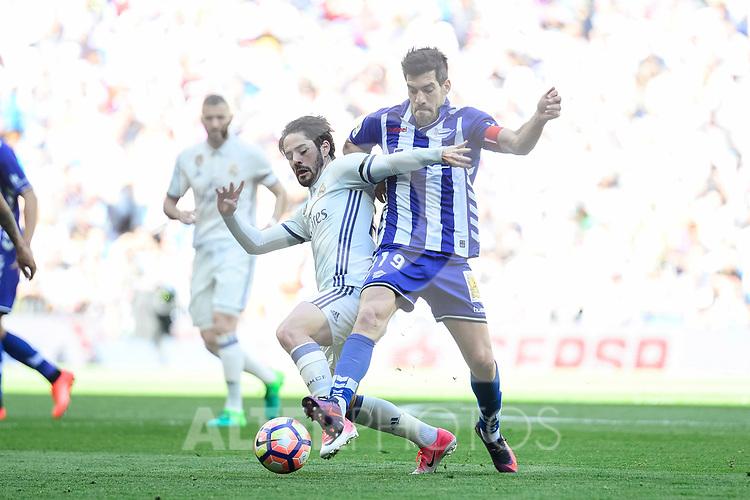"Real Madrid's Francisco Roman ""Isco"" and Deportivo Alaves's Manuel Alejandro Garcia during La Liga match between Real Madrid and Deportivo Alaves at Stadium Santiago Bernabeu in Madrid, Spain. April 02, 2017. (ALTERPHOTOS/BorjaB.Hojas)"