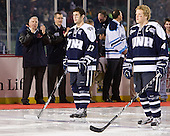 Kevin Goumas (UNH - 27), Damon Kipp (UNH - 4) - The University of Maine Black Bears defeated the University of New Hampshire Wildcats 5-4 in overtime on Saturday, January 7, 2012, at Fenway Park in Boston, Massachusetts.