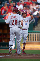 Frisco RoughRiders Edwin Garcia (11) congratulates Trever Adams (29) after hitting a home run during a game against the Springfield Cardinals  on June 4, 2015 at Hammons Field in Springfield, Missouri.  Frisco defeated Springfield 8-7.  (Mike Janes/Four Seam Images)